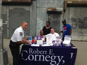 Deputy Inspector John M. Chell, of the 79th Precinct (seated) with one of his colleagues and representatives from Councilmember Robert Cornegy's office